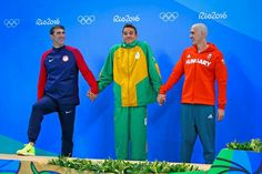 RIO DE JANEIRO, BRAZIL - AUGUST 12: Joint silver medalists, (L-R) Michael Phelps of United States, Chad Guy Bertrand le Clos of South Africa and Laszlo Cseh of Hungary celebrate winning silver in the Men's 100m Butterfly Final on Day 7 of the Rio 2016 Olympic Games at the Olympic Aquatics Stadium on August 12, 2016 in Rio de Janeiro, Brazil. (Photo by Clive Rose/Getty Images) — with AbdulHamid T Lajinef, Michael Phelps, Chad Le Clos and László Cseh in Rio de Janeiro, Brazil.