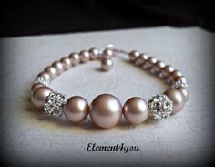 Bridal bracelet, Bridesmaid gift, Pearl Bracelet, Swarovski ivory champagne pearls, Rhinestone ball, Wedding jewelry, Maid of honor gift. $26.00, via Etsy.