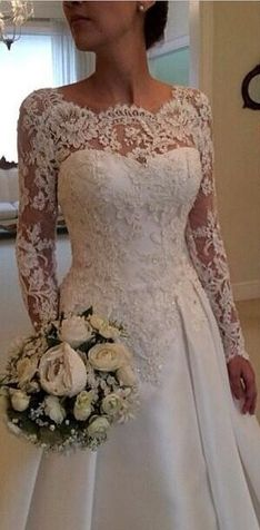 Beautiful long sleeved wedding gown with a stunning, intricate neckline.