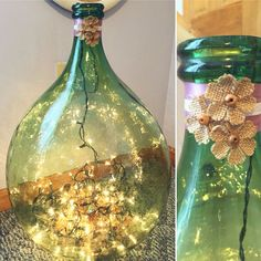 Simple Demi John decor; Christmas lights and tinsel for extra shine and ribbon with fabric flowers for detail