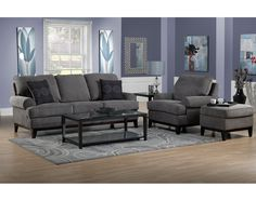 Modern Living. Contemporary yet comfortable style is on display with the Crizia sofa with its clean lines and cozy charm. The ample cushions on the seats and backs complement the comfy roll arms and welted detailing. An exposed wood base frame with off-the-floor styling, tapered feet and an on-trend charcoal grey designer fabric provide the chic finishing touches. Made in Canada.