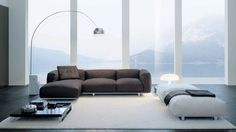 Daytona sofa by Alivar; Arco floor lamp by Flos; and Nesso table lamp by Artemide