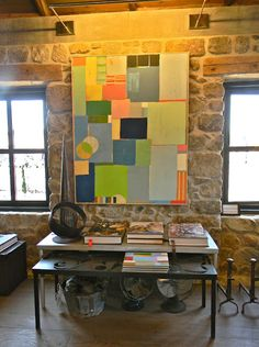 Art. LOVE how this painting is used in an authentic living/work space.