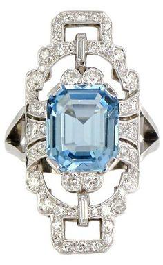 Very Fine Aquamarine Diamond  Panel Ring, Art Deco style. An 18ct white gold aquamarine ring, comprising a 4.11ct emerald cut aquamarine, within a geometric diamond set surround, mounted on a bifurcated white gold shank.