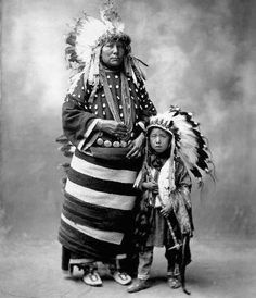 Dollie Her Horse Stand-Bird Head, (the wife of William Bird Head), and their son Joseph Bird Head - Oglala - 1899