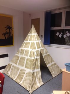 Pyramid for role play area, created with bamboo canes, an old bed sheet, some masking tape and gold spray paint :-)