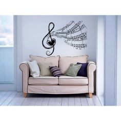 Bring added excitement to your walls with this fun wall vinyl decal. This easy-to-apply vinyl decal features a notes wave and a music treble clef.