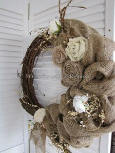 #Burlap rose and feather #grapevine #wreath  www.facebook.com/wreathswithareason