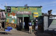 Residents stand outside a spaza convienience shop in Cape Town's Imizamo Yethu township, April REUTERS/Mike Hutchings Senegal Africa, South Africa, Savings And Investment, Supermarket Design, Derelict Buildings, Store Image, World Economic Forum, African Art, Manchester United