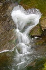 Love waterfalls? This one actually loves you back.  (photo by Nick Zungoli)  #hearts www.finditforweddings.com