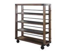Rustic shelf with metal wheels by Magnussen.