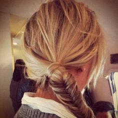 Messy ponytail with fishtail braid end