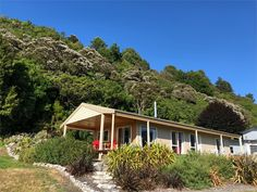 This house is unavailable Abel Tasman National Park, Open Fireplace, Innisfree, Stargazing, Places To Go, National Parks, Cabin, Sea, House Styles