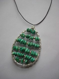 Turquoise and Silver Wire-Wrapped Pendant on Leather Cord