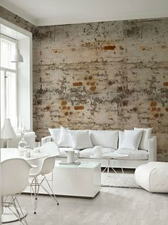"In the living/dining room, the ""tall wall."" interior design with brick wall"