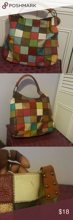 Stella&Max handbag Multi color Stella & Max in good condition, inside is brown in color, no rips or tear, no scuffing on the outside corners. Only issue is 2 tiny pen marks which can barely be seen. Measures 12in long and 12in wide. Beautiful hobo style bag Stella&Max Bags Hobos