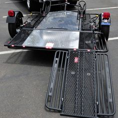 Part #: BB207RULE Limited Edition Dual Rail Ride On Trailer for Motorcycles - Fits Cruiser style bikes, incl. Harley Davidson, Yamaha Star, Goldwing, Sport Bikes and more. Weight: 450 lbs Capacity: 2,000 lbs Standing Height: 93½ inches Max Width: 86 inches Max Length: 123 inches Depth: 27 inches