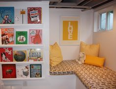 Sweet reading nook and I always love the books facing out.