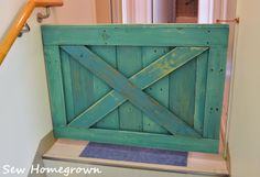 Barndoor Baby Gate - or maybe a doggie gate. I love this look rather than those plastic things from the stores!