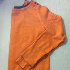The Limited sweater Burnt rust colored sweater . The Limited 50% merino wool 50% acrylic long sleeve , 3 buttons on shoulders . Ribbed waist band . Very soft nice sweater !! The Limited Sweaters