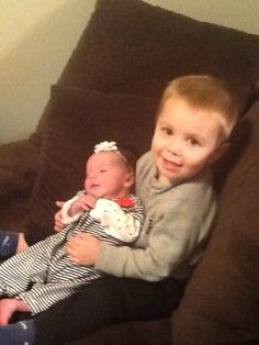 Blake holding Kinsley for the first time.