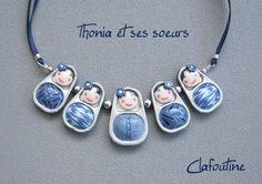 collar de matrioskas hechas con las chapas de las latas de Clafoutine