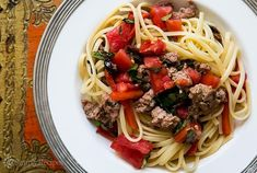 Pasta tossed with Italian sausage, roasted red bell peppers, olives, capers, fresh tomato and basil