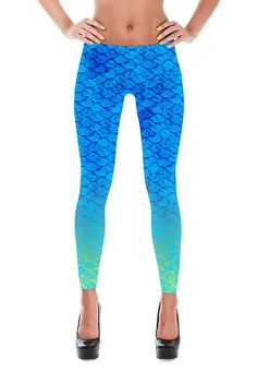 """Blue Mermaid fish scale leggings. Shiny, durable and hot. These polyester/spandex leggings will never lose their stretch and provide that support and comfort you love in unique designs.Made of polyester/spandex fabricFabric - 86% Polyester, 14% Spandex100% printed, cut and sewn in CaliforniaElastic waistband Check the sizing chart below for detailed measurements.       XS S M L XL     Waist  25"""" 28"""" 30"""" 35"""" 37""""   Hips  35"""" 38"""" 41"""" 45"""" 49""""     This sizing chart is approximate.  Alignment…"""