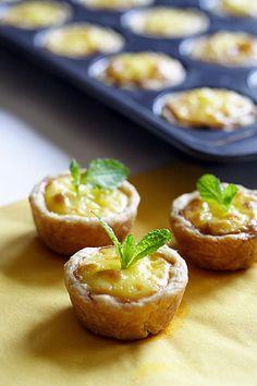 Mini Portuguese Egg Tarts - Pie crust, egg yolks, sugar, milk, heavy whipping cream, vanilla
