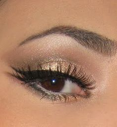 Love the subtle inner lining of the eye and the double outer winged liner. Chic!
