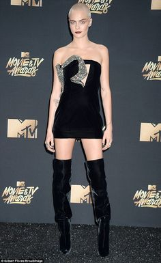 Turning heads: Cara Delevingne proved she can pull off any look as she attended the MTV Movie and TV Awards in California on May 7, 2017