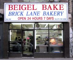 "Beigel Bake, Brick Lane E2  (Note the old spelling of ""beigel"" before the American spelling ""bagel"" became more common)."