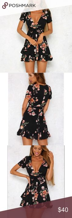 Hello Molly Black Floral Wrap Dress - Small Australian brand Hello Molly  Gorgeous black wrap dress with red pink and white flowers suitable for fall summer spring or winter Perfect condition  Nice heavy fabric - well made  Ruffle accents short sleeves plunging neckline and comes with tie belt to adjust the fit  Super pretty feminine flirty girly with a cool girl edge  Size small Hello Molly Dresses Mini