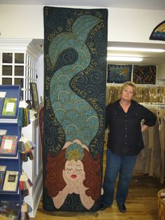 Sue Cunningham with another spectacular mermaid rug. Be sure to read the words!