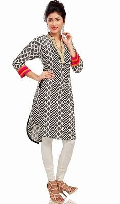 Black, off white embroidered cotton kurti is perfect for any evening religious function. Kurti is embellished with block print, woven lace, Silk thread embroidered floral patch in back and multi color patti on sleeves which gives you an alluring look. #ClassicalTunic