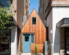 sans-arc studio tucks pink moon saloon into alleyway in australia
