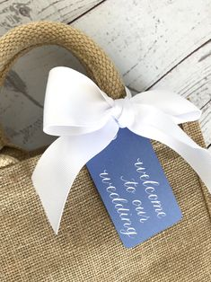 A personal favorite from my Etsy shop https://www.etsy.com/listing/593584912/welcome-to-our-wedding-tag-wedding