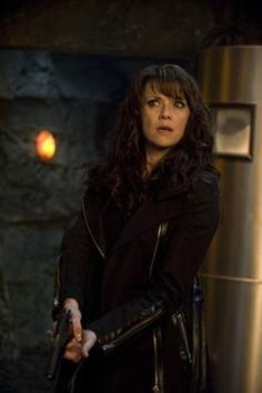 "Helen Magnus aka ""Bullets and Leather Magnus""  of Sanctuary played by Amanda Tapping.  Helen is a 157 in the first episode and 273 by that last thanks to a 113 year trip back in time.  She doesn't age, is a doctor of teratology and cryptozoology, has an enormous library in a Gothic mansion,  her ex is Jack the Ripper, her best friend the half vampire Nikola Tesla, she knows how to shoot and can beat the crap out of Adam Worth aka Jekyll/Hyde."