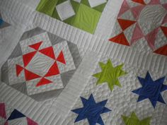 I like the horizontal quilting in the sashing
