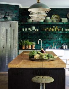 dark green kitchen a dark green tile backsplash is extended on the whole wall, and green lamps echo it Dark Green Kitchen, Green Kitchen Decor, Green Kitchen Cabinets, Kitchen Themes, Kitchen Colors, Kitchen Ideas, Kitchen Island, Teal Kitchen, Dark Cabinets
