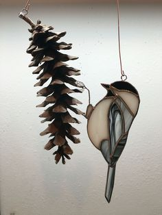 Stained glass chickadee on a pine cone sun catcher . #StainedGlassChristmas