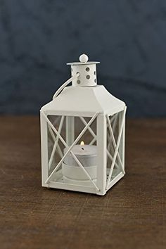 Set ot 12 white metal and glass tealight lanterns. Each is tall and hang or place on tables. The petite lantern has glass panes on all . Cheap Lanterns, Hanging Candle Lanterns, Small Lanterns, White Lanterns, Lantern Candle Holders, Summer Centerpieces, Lantern Centerpieces, Wedding Centerpieces, Wedding Shower Decorations