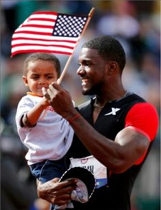 Justin Gatlin hands his son Jace a US flag as he celebrates winning the men's during the US Olympic Trials in Eugene, Oregon. Justin Gatlin, Olympic Trials, Us Olympics, Eugene Oregon, 100m, Getting Old, Gorgeous Men, The Man, Flag
