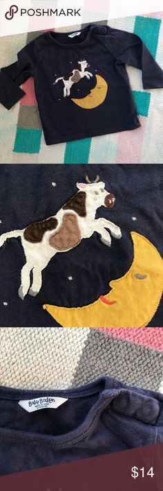 Baby Mini Boden navy cow over the moon applique Sweet Mini Boden applique long sleeve tee featuring the cow jumping over the moon. Dark navy; snaps at neck. There is the teeniest of spots on the cow (pictured) and otherwise EUC. Size 12-18 months TTS.  Kids clothes are the best deal on Posh when bundled!  Please check out my other stuff & make a bundle for a great offer. Mini Boden Shirts & Tops Tees - Long Sleeve