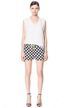 Plain and simple! i'm obsessed with #GINGHAM # blackandwhite #checkereds #balcandwhiteplaid that's it! From #zarausa