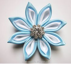 Flor kanzashi cristal. #kanzashi #cintas #fitas #ribbons Bun Wrap, Making Fabric Flowers, Butterfly Decorations, Kanzashi Flowers, Ribbon Art, Wedding Crafts, Flower Crafts, Baby Headbands, Flowers In Hair