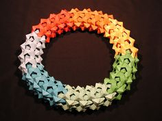 Dodecahedral Mega-Structure (Modular Origami) by One Small Crease Origami Paper Art, Origami Art, Diy Paper, Paper Crafts, Origami Flowers, Irises, Origami Modular, Origami Videos, Traditional Japanese Art