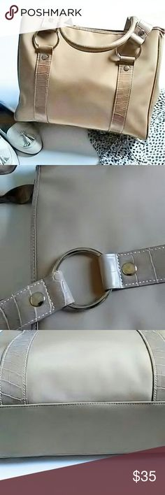 CASUAL CORNER TOTE BAG Large Casual Corner tote bag with silver color hardware. Measured flat approximately 11x13x4x4.  Classic tan color with center zipper pocket. 2 Side zipper pockets and extra side pockets too. Room enough to carry everything needed.  EUC ASK ALL QUESTIONS B4 YOU BUY. Bags Totes