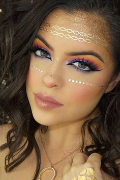 Loving this Festival inspired make-up. Our Fabulous Metallic Tattoos can be used to help achieve this look. http://www.secretfashionfixes.ie/metallic-tattoos--4-sheet-pack/mettattoopd.html
