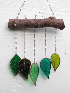 Glass Leaves Sun Catcher Mobile Five glass leaves all hand made using the Tiffany copper foil method with a mixture of green streaked, rippled and textured glass. Great Christmas gift. Beautiful mix of colours in sunlight and in the breeze makes a soothing sound. Casts a great colourful
